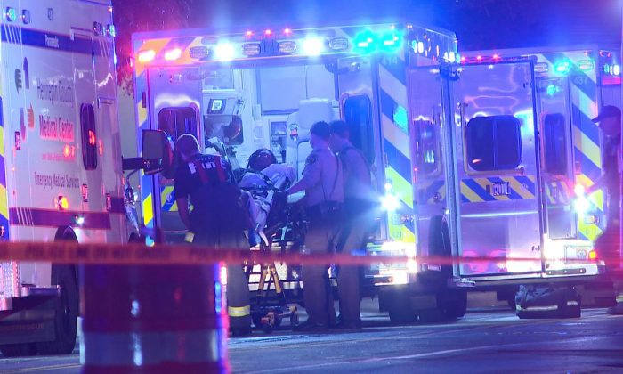 A person is brought into an emergency vehicle after a shooting in Minneapolis on Oct. 3, 2016. (KARE via AP)