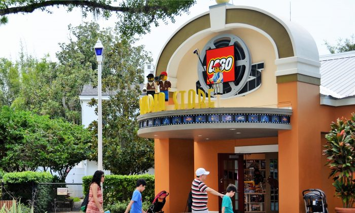 A family walks by an attraction at Legoland Florida in Winter Haven, Fl. on Sept. 29, 2016. (Yvonne Marcotte/Epoch Times)