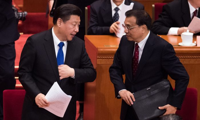 Chinese leader Xi Jinping and Chinese premier Li Keqiang at the Great Hall of the People in Beijing on March 3, 2016. (Johannes Eisele/AFP/Getty Images)