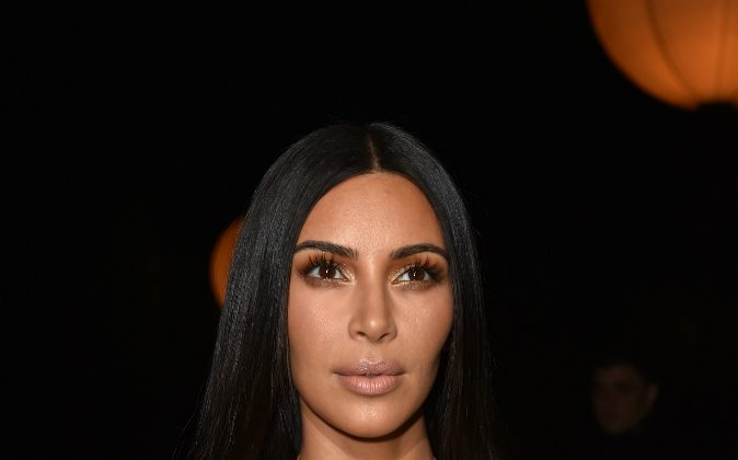 Kim Kardashian attends the Givenchy show as part of the Paris Fashion Week Womenswear Spring/Summer 2017 on October 2, 2016 in Paris, France. Kardashian will reportedly take a month break from work and will change how she uses social media. (Pascal Le Segretain/Getty Images)