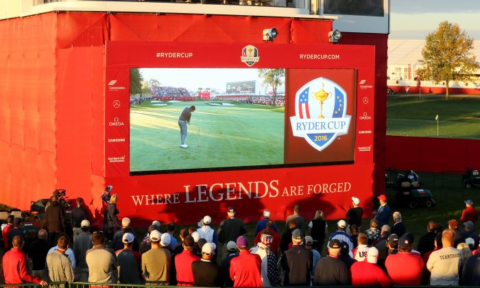 Fans watch a video board during morning foursome matches of the 2016 Ryder Cup at Hazeltine National Golf Club. (Andrew Redington/Getty Images)