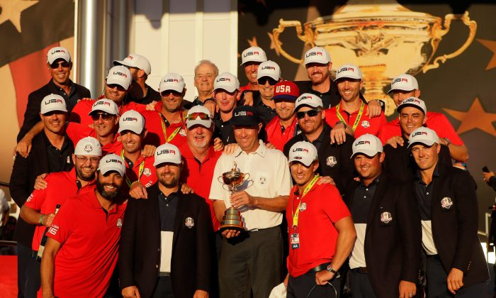Captain Davis Love III of the United States celebrates with his team and their caddies during the closing ceremony of the 2016 Ryder Cup at Hazeltine National Golf Club on October 2. (Jamie Squire/Getty Images)