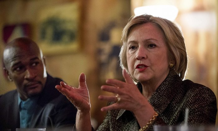 Democratic presidential candidate Hillary Clinton meets with African American community leaders at Mert's Heart & Soul in Charlotte, N.C., Sunday, Oct. 2, 2016, to discuss the urgency of addressing racial, economic and social justice issues. (AP Photo/Andrew Harnik)
