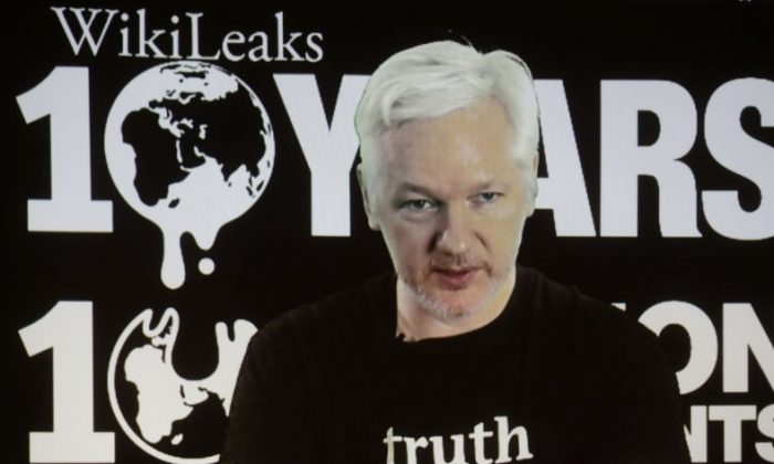 WikiLeaks founder Julian Assange participates via video link at a news conference marking the 10th anniversary of the secrecy-spilling group in Berlin, Germany, Tuesday, Oct. 4, 2016. Assange said that WikiLeaks plans to start a series of publications this week, but wouldn't specify the timing and subject. (AP Photo/Markus Schreiber)