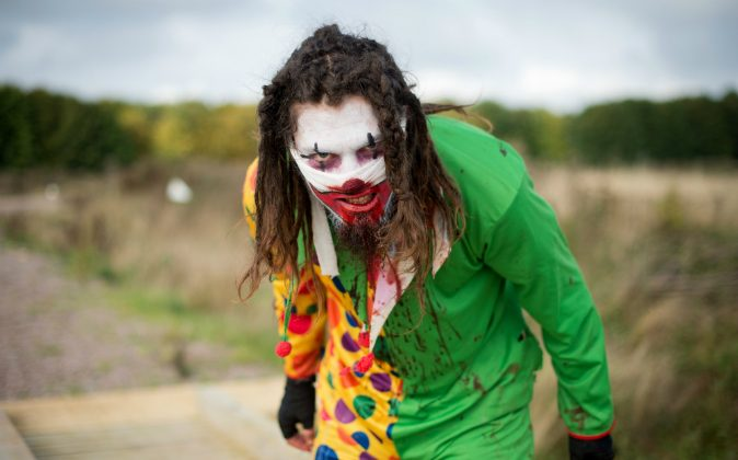 A zombie clown prepares for the runners as he takes part in one of Britain's biggest horror events, the 'Zombie Evacuation Race' at Carver Barracks near Saffron Walden, England, on October 5, 2013. Three clowns in Chicago reportedly threatened elementary school students on Oct. 4. (LEON NEAL/AFP/Getty Images)
