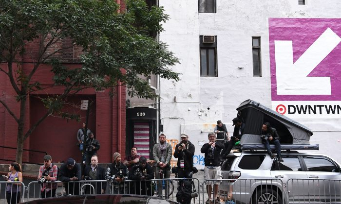 """Paparazzi camp outside Kanye West and Kim Kardashian's apartment in New York on October 4, 2016. Kim Kardashian freed herself and raised the alarm after being tied up and robbed at gunpoint in Paris of  USD 10 million in jewels in Paris, police sources said. The mother of two and wife of rap superstar Kanye West flew home to the US on Monday after being questioned by police over the incident, which a spokeswoman said had left her """"badly shaken"""". / AFP / Angela WEISS        (Photo credit should read ANGELA WEISS/AFP/Getty Images)"""