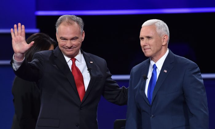 Democratic vice presidential candidate Tim Kaine (L) and Republican vice presidential candidate Mike Pence (R) arrive on stage for the US vice presidential debate at Longwood University in Farmville, Virginia on October 4, 2016. (PAUL J. RICHARDS/AFP/Getty Images)