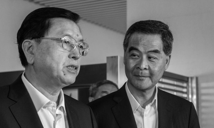 Former Politburo Standing Committee member (left) Zhang Dejiang and former Hong Kong chief executive Leung Chun-ying in Hong Kong on May 19, 2016. (Anthony Wallace/AFP/Getty Images)