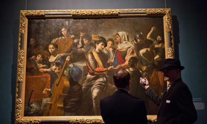 Visitors preview an exhibit of French painter Valentin de Boulogne at the Metropolitan Museum, October 5, 2016, in New York. (DOMINICK REUTER/AFP/Getty Images)