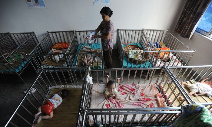 A Chinese worker cares for the babies at an orphanage in Wuhu, in eastern China's Anhui province on August 7, 2009. (AFP/AFP/Getty Images)
