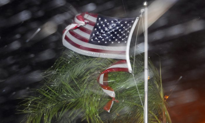 An American flag is ripped to shreds from heavy rain and wind from Hurricane Matthew early Friday, Oct. 7, 2016 in Cape Canaveral, Fla. (Craig Rubadoux/Florida Today via AP)