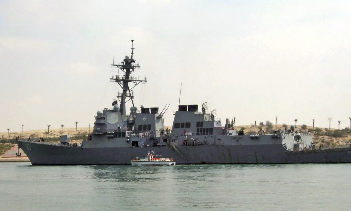 In this Saturday, March 12, 2011 file photo, U.S. destroyer USS Mason sails in the Suez canal in Ismailia, Egypt. Two missiles fired from rebel-held territory in Yemen landed near an American destroyer passing by in the Red Sea, the U.S. Navy said on Monday, Oct. 10, 2016. (AP Photo/File)
