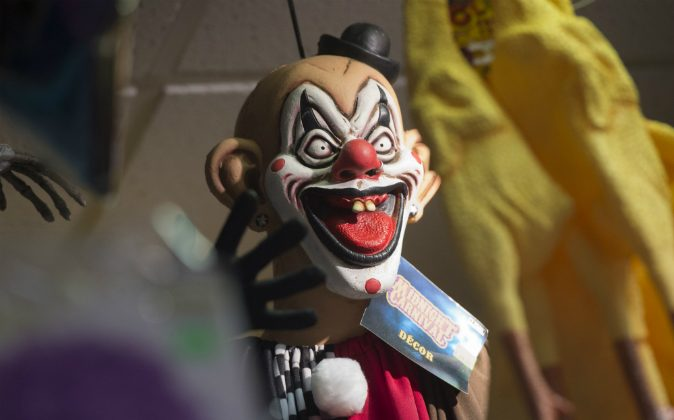 Halloween costumes and props, including a 'scary' clown mask, are seen for sale at Total Party, a party store, in Arlington, Virginia, October 7, 2016. Clown sightings have been reported in England, Australia, and Canada. (SAUL LOEB/AFP/Getty Images)