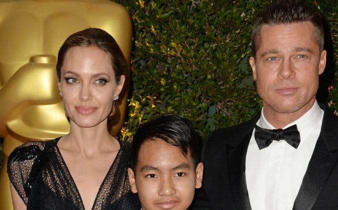 Actress Angelina Jolie, Maddox Jolie-Pitt (C) and actor Brad Pitt arrive for the 2013 Governors Awards, presented by the American Academy of Motion Picture Arts and Sciences (AMPAS), at the Grand Ballroom of the Hollywood and Highland Center in Hollywood, CA., on Nov. 16, 2013. (ROBYN BECK/AFP/Getty Images)