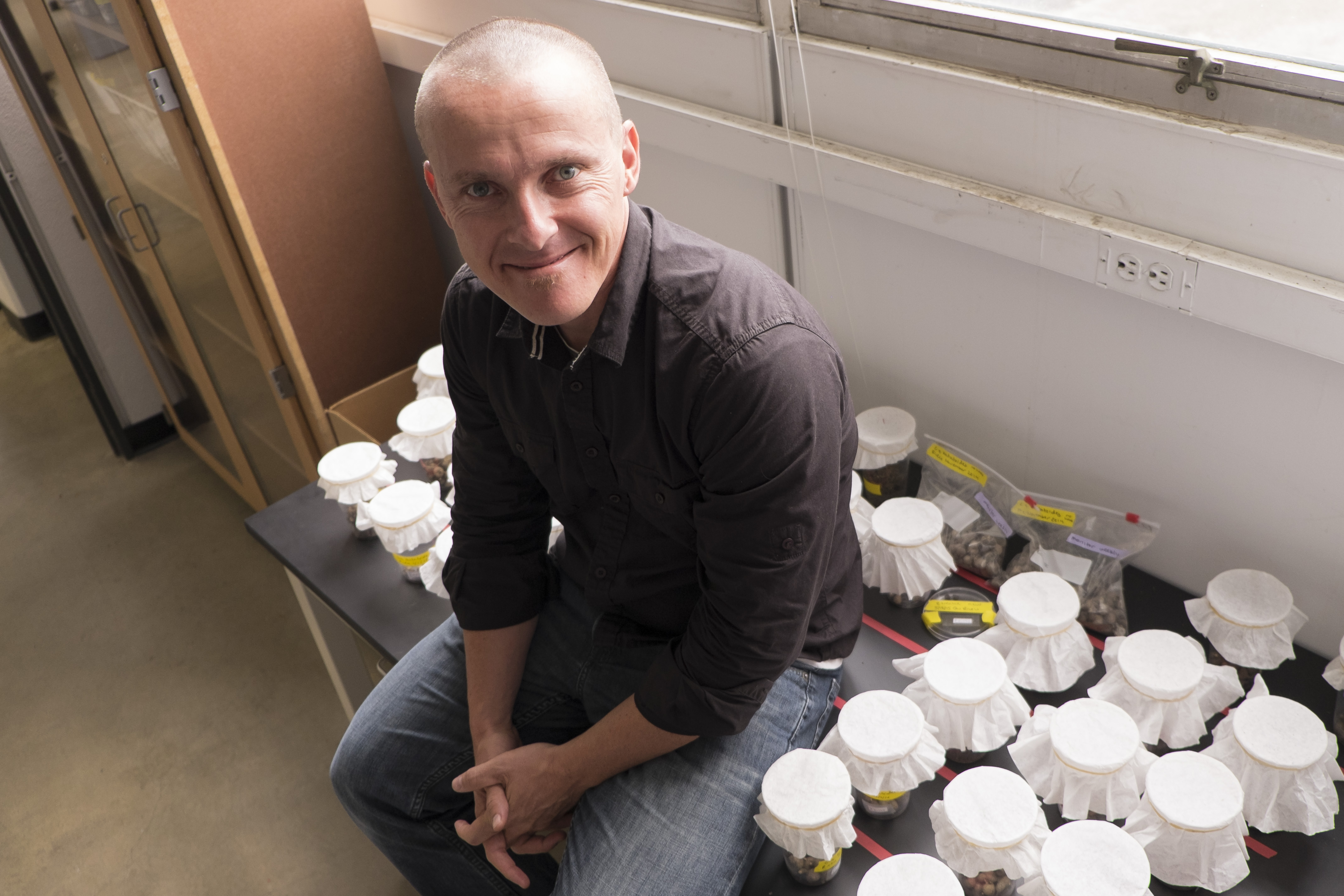Scott Egan, an assistant professor of biosciences at Rice University, is leading a project to develop technology that will monitor and quantify genetically engineered organisms and their byproducts in the environment. ( Jeff Fitlow/Rice University)