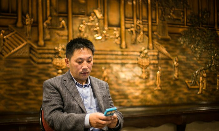 Li Hongkuan uses the Chinese social media app WeChat, in Flushing, New York, on Oct. 4. WeChat offers the potential for activists to disseminate more subversive content, but with a more limited audience, in China. (Matthew Robertson/Epoch Times)