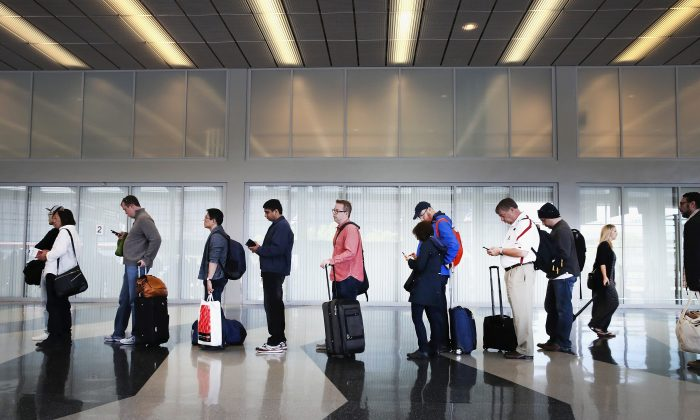 Passengers at O'Hare International Airport wait in line to be screened at a Transportation Security Administration (TSA) checkpoint on May 16, 2016 in Chicago, Illinois. (Photo by Scott Olson/Getty Images)