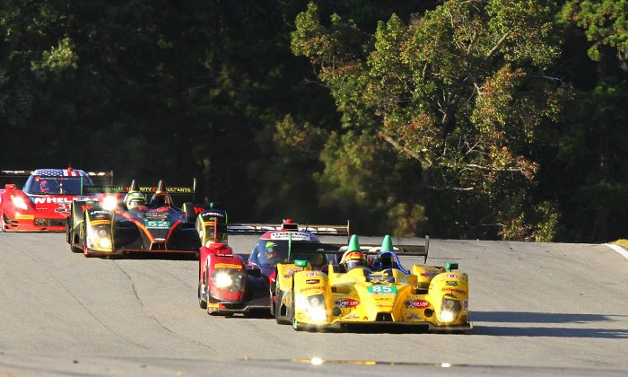 The #85 JCD-Miller Oreca leads the #70 Mazda Prototype, the #52 PR1-Mathiesen Oreca, and the #31 AXR Coyote-Corvette over the crest after Turn Five halfway through the 2016 Petit Le Mans. (Chris Jasurek/Epoch Times)