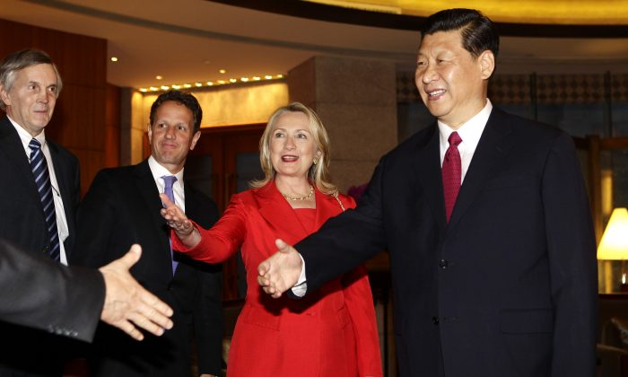 Chinese leader Xi Jinping meets U.S. Secretary of State Hillary Clinton, U.S. Treasury Secretary Timothy Geithner (2nd R) and other delegates during a meeting at Diaoyutai State Guesthouse in Beijing, on May 3, 2012. (Jason Lee/AFP/GettyImages)