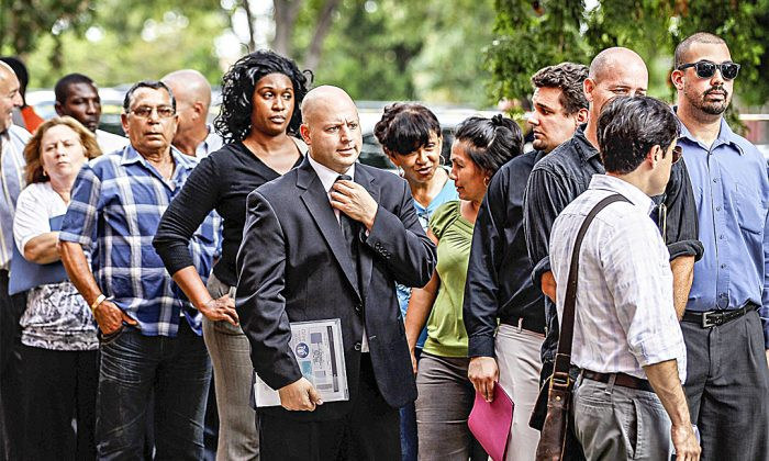 Job seekers line up to apply for one of 2,000 openings with Major League Baseball's Miami Marlins in this file photo. (Joe Readle/Getty Images)