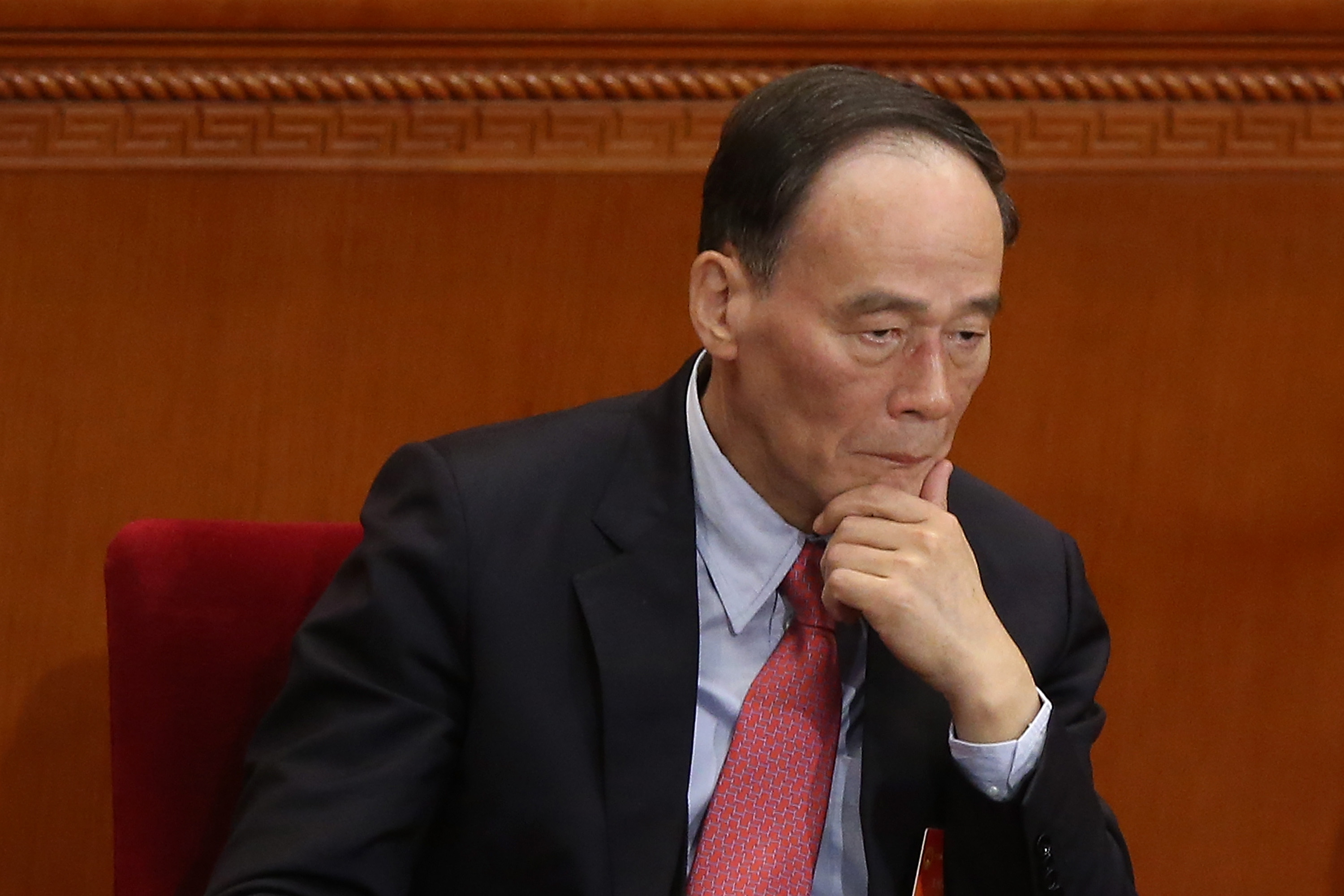 Anti-corruption chief Wang Qishan at the Great Hall of the People in Beijing on March 5, 2014. Recently, anti-corruption investigators criticized the 610 Office, an extralegal Party organization that oversees the persecution of Falun Gong, in a feedback report. (Feng Li/Getty Images)