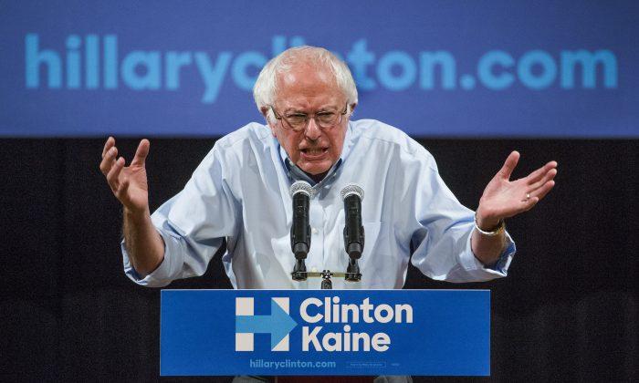 Bernie Sanders addresses a Clinton-Kaine rally inside the Prochnow Auditorium at Northern Arizona University on Oct. 18. (Tom Tingle/The Arizona Republic via AP)