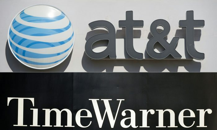 A montage of the logos of AT&T and Time Warner. After a protracted trial, the $85 billion merger is allowed to proceed, thanks to a healthy dose of economic reality. (Saul Loeb; Stan Honda/AFP/Getty Images)