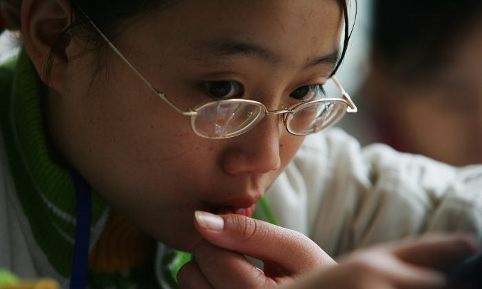 A schoolgirl from the mountain regions studies at an experimental school in Chengdu, capital of southwest China's Sichuan Province, on Nov. 7, 2007. (Guang Niu/Getty Images)
