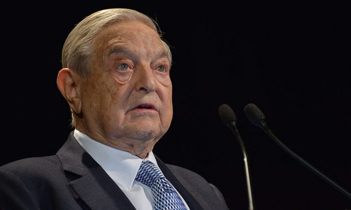 George Soros, billionaire and political activist, speaks at the Waldorf-Astoria hotel on November 6, 2013, in New York City. (Coppola/Getty Images for International Rescue Committee)