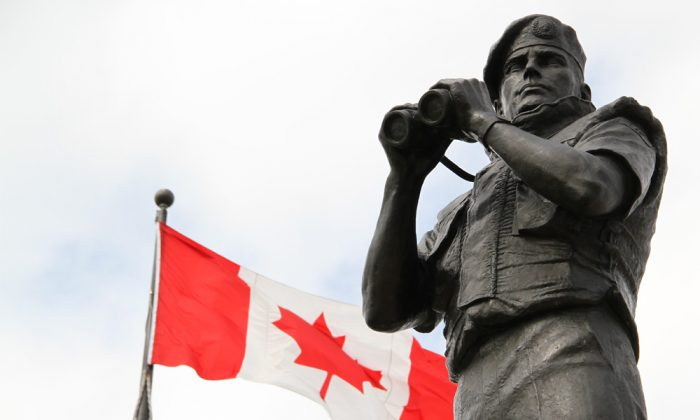 One of three statues of Canadian soldiers that are part of Reconciliation, known popularly as the Peacekeeping Monument, in Ottawa on April 15, 2012. (Ken Banks via Wikimedia Commons)