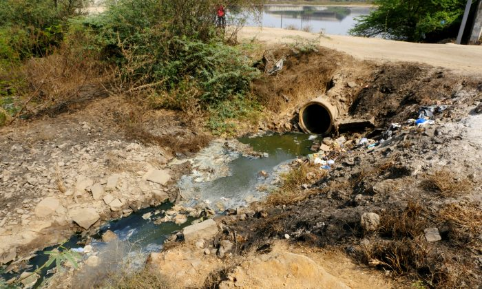 A file photo of a pipe discharging effluent from a factory that manufactures pharmaceuticals, owned by the company Aurobindo, in Bollaram, India. (Courtesy of Changing Markets)