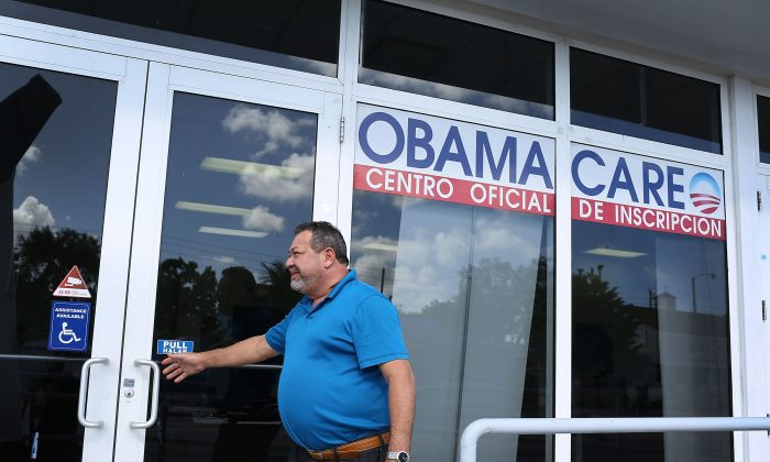A person walks into the UniVista Insurance company office where people sign up for health care plans under the Affordable Care Act, also known as Obamacare, in Miami on Dec. 15, 2015. (Joe Raedle/Getty Images)