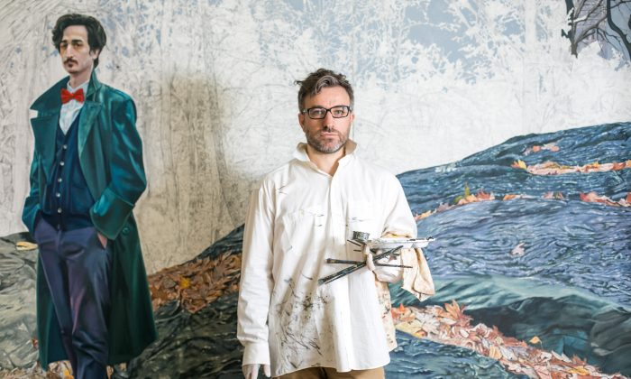 """Fernando Martin Diez-Cabeza with his unfinished painting """"The Gentleman With the Red Bow Tie,"""" at his apartment in New York on Aug. 28, 2016. (Benjamin Chasteen/Epoch Times)"""