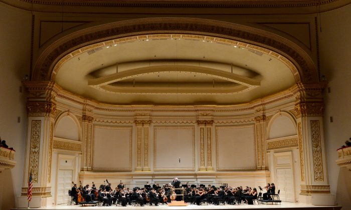 Argentinian-born conductor Daniel Barenboim directs the West-Eastern Divan Orchestra in Beethoven's Symphony No. 4 on January 31, 2013 at Carnegie Hall in New York. (STAN HONDA/AFP/Getty Images)