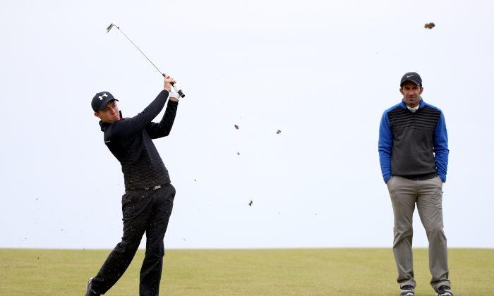 Matthew Fitzpatrick of England plays his second shot to the 18th hole as his playing partner Luis Figo looks on during the second round of the Alfred Dunhill Links Championship on the Golf Links course, Kingsbarns on October 7, 2016 in Kingsbarns, Scotland. (Ian Walton/Getty Images)