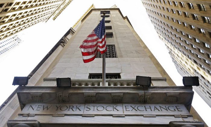 The American flag flies above the Wall Street entrance to the New York Stock Exchange on Nov. 13, 2015. (AP Photo/Richard Drew)