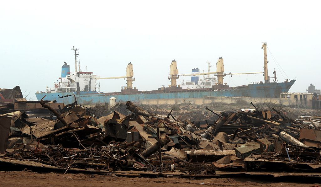A recently beached cargo vessel waits to be dismantled at a ship-breaking plot in Geddani, Pakistan, on July 11, 2012. (Roberto Schmidt/AFP/Getty Images)