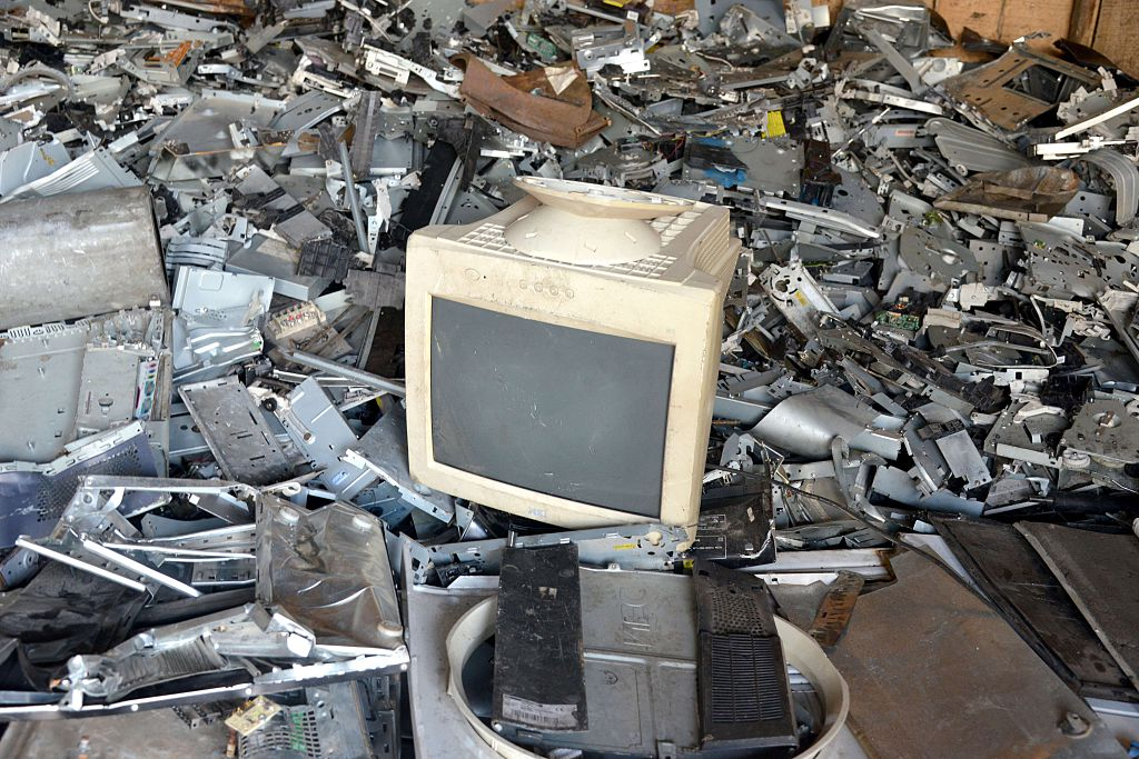 A computer screen is placed on a pile of scrap metal at a breakage yard, where old electrical and electronic items are sold in a district of Abidjan, Ivory Coast, on October 8, 2015. (Issouf Sanogo/AFP/Getty Images)
