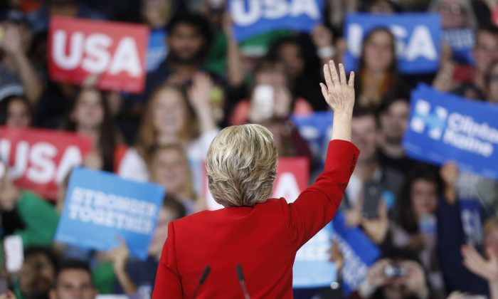 Democratic presidential candidate Hillary Clinton waves to the crowd during a campaign rally at Kent State University, Monday, Oct. 31, 2016, in Kent, Ohio. (AP Photo/John Minchillo)