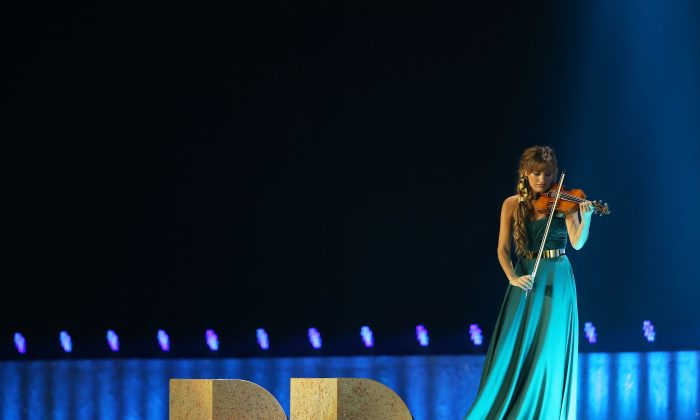 GLASGOW, SCOTLAND - JULY 23:  Nicola Benedetti performs during the Opening Ceremony for the Glasgow 2014 Commonwealth Games at Celtic Park on July 23, 2014 in Glasgow, Scotland.  (Photo by Chris Jackson/Getty Images)