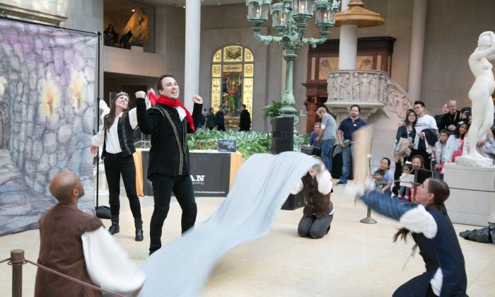 """Actors from the TITAN Theatre Company perform """"The Fifteen Minute Hamlet,"""" a comedic rapid-fire take on the Shakespeare classic, at the Charles Engelhard Court in the Metropolitan Museum of Art in New York on Nov. 5, 2016. (Benjamin Chasteen/Epoch Times)"""