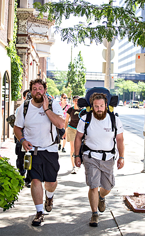 Anthony Anderson (L) and Tom Voss in Milwaukee on Aug. 30, 2013, as they start out on the Veterans Trek. (almost sunrise)