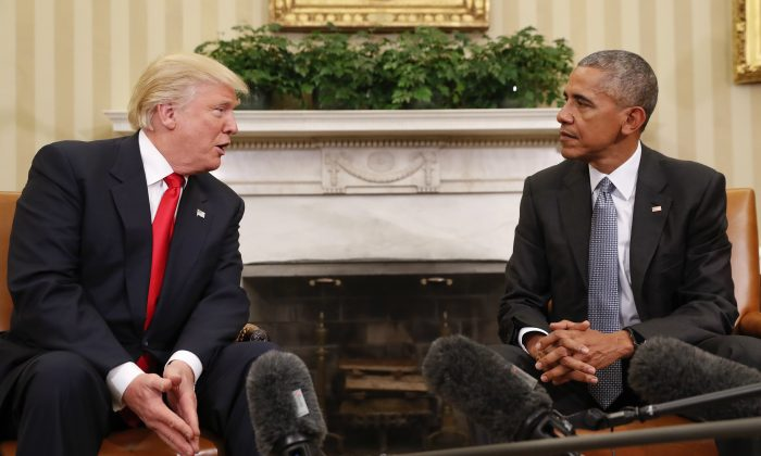 President Barack Obama listens to President-elect Donald Trump speak during their meeting in the Oval Office of the White House in Washington on Nov. 10, 2016. (AP Photo/Pablo Martinez Monsivais)