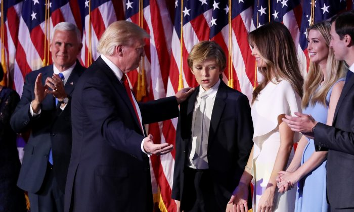 Republican president-elect Donald Trump acknowledge his son Barron Trump (C) after delivering his acceptance speech at the New York Hilton Midtown in  in New York City, on Nov. 9, 2016.  (Photo by Joe Raedle/Getty Images)