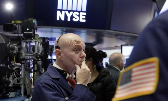 Trader Daniel Porin works on the floor of the New York Stock Exchange, Wednesday, Nov. 9, 2016. How will markets fare with the tax reform finally passed? (AP Photo/Richard Drew)