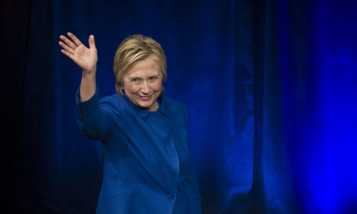Hillary Clinton waves after addressing the Children's Defense Fund's Beat the Odds celebration at the Newseum in Washington on Nov. 16, 2016. (AP Photo/Cliff Owen)