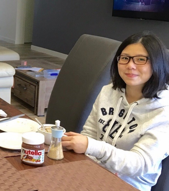 Rabee enjoying a Western style snack, in Brisbane, during August 2016. (Linda Huang/NTD Television)
