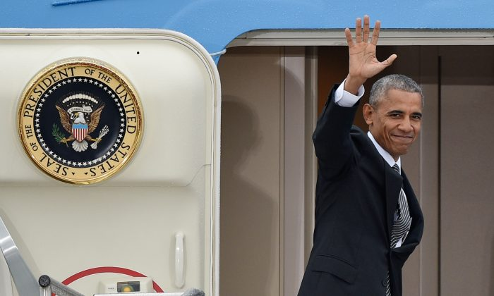 President Barack Obama  waves as he departs from  Tegel airport in Berlin on Nov. 18, 2016. Obama met the leaders of key European countries to discuss an array of security and economic challenges facing the trans-Atlantic partners as the U.S. prepares for President-elect Donald Trump to take office in January. (Rainer Jensen/dpa via AP)