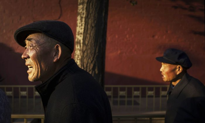 Chinese retirees walk on the street in Beijing Oct. 16, 2014. (Kevin Frayer/Getty Images)