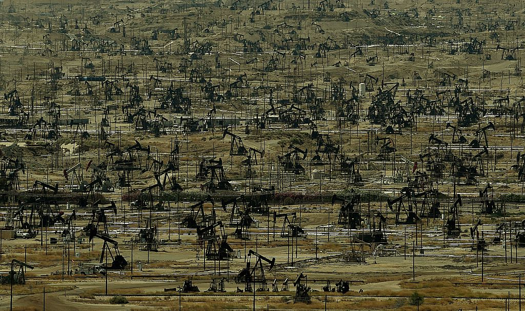 An oil field with a large number of pumping jacks operating in the Central Valley of California is seen on June 24, 2015.    (Mark Ralston/AFP/Getty Images)